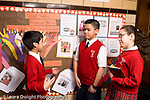 K-8 Parochial School Bronx New York Grade 5 class election male candidate talking to boy and girl horizontal