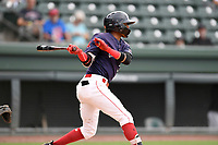 Center fielder Kervin Suarez (36) of the Greenville Drive bats in Game 1 of a doubleheader against the Hickory Crawdads on Wednesday, July 25, 2018, at Fluor Field at the West End in Greenville, South Carolina. Greenville won, 4-1. (Tom Priddy/Four Seam Images)