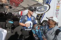 Feb. 17, 2013; Pomona, CA, USA; NHRA funny car driver Matt Hagan signs autographs during the Winternationals at Auto Club Raceway at Pomona. Mandatory Credit: Mark J. Rebilas-