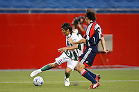 Santos Laguna forward Oribe Peralta (23) and New England Revolution defender Michael Parkhurst (15). The New England Revolution defeated Santos Laguna 1-0 during a Group B match of the 2008 North American SuperLiga at Gillette Stadium in Foxborough, Massachusetts, on July 13, 2008.