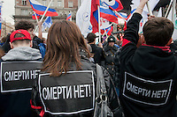 "Moscow, Russia, 31/03/2010..People wearing posters reading ""no the death"" at a government sponsored rally against terrorism, organised by a range of pro-Kremlin youth movements, two days after the suicide bombings that killed 39 and injured 82 on the Moscow metro system."