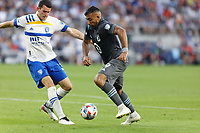 SAINT PAUL, MN - JULY 3: Ramon Abila #9 of Minnesota United FC and Nathan #13 of the San Jose Earthquakes battle for the ball during a game between San Jose Earthquakes and Minnesota United FC at Allianz Field on July 3, 2021 in Saint Paul, Minnesota.