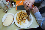 Brown sauce with  sausage egg and chips. Regency Café  Westminster London SW1 UK.