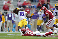 Arkansas defensive back Myles Slusher (2) grabs a hold of LSU running back Chris Curry (18), Saturday, November 21, 2020 during the first quarter of a football game at Donald W. Reynolds Razorback Stadium in Fayetteville. Check out nwaonline.com/201122Daily/ for today's photo gallery. <br /> (NWA Democrat-Gazette/Charlie Kaijo)