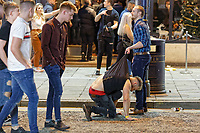 Pictured: A man is helped up by his friend in Wind Street, Swansea. Monday 31 December 2018 and Tuesday 01 January 2019<br /> Re: New Year revellers in Wind Street, Swansea, Wales, UK