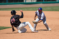 Stockton Ports second baseman Nate Mondou (10) prepares to apply the tag to Drew Ellis (10) on a stolen base attempt during a California League game against the Visalia Rawhide at Visalia Recreation Ballpark on May 9, 2018 in Visalia, California. Stockton defeated Visalia 4-2. (Zachary Lucy/Four Seam Images)