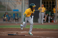 AZL Athletics left fielder George Bell (21) starts down the first base line during an Arizona League game against the AZL Giants Black at the San Francisco Giants Training Complex on June 19, 2018 in Scottsdale, Arizona. AZL Athletics defeated AZL Giants Black 8-3. (Zachary Lucy/Four Seam Images)