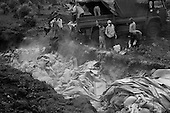 Goma, Zaire<br /> July 1994<br /> <br /> Dead ethnic Rwandan Hutu civilians are dumped into a mass grave in Zaire. <br /> <br /> Following the 1994 Rwandan Genocide, in which Hutu militia groups and the Hutu lead Rwanda military, killed an estimated 800,000 ethnic Tutsis and sympathizers during a 100-day killing spree, 2 million ethnic Hutu?s, fearing reprisals, flee the country. The vast majority went to Goma, Zaire as tens of thousands died in epidemics of cholera and dysentery that swept the roadside crowds and refugee camps. People who had actively participated in the genocide hid among the refugees, fueling the First and Second Congo Wars.<br /> <br /> The international community, and the United Nations in particular, drew severe criticism for its inaction in the wake of the Rwandan Genocide.
