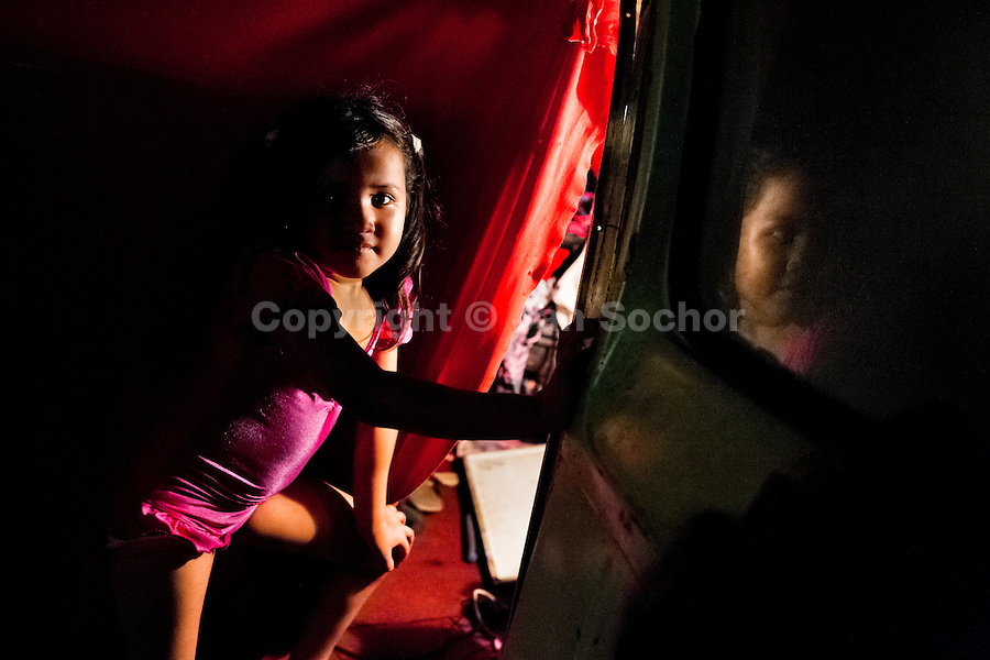 A Salvadorean girl, dressed up as a dancer, enters in the trailer before a performance at the Circo Brasilia, a family run circus travelling in Central America, 10 May 2011. The Circo Brasilia circus belongs to the old-fashioned traveling circuses with a usual mixture of acrobat, clown and comic acts. Due to the general loss of popularity caused by modern forms of entertainment such as movies, TV shows or internet, these small family enterprises balance on the edge of survival. Circuses were pushed away and now they have to set up their shows in more remote villages. The circus art and culture is slowly dying in Latin America.