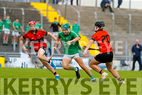 Kieran O'Carroll Ballyduff in action against David O'Sullivan and Charlie Fitzgerald Ballyheigue during the Kerry County Minor Hurling Championship Final match between Ballyduff and Ballyheihue at Austin Stack Park in Tralee, Kerry.