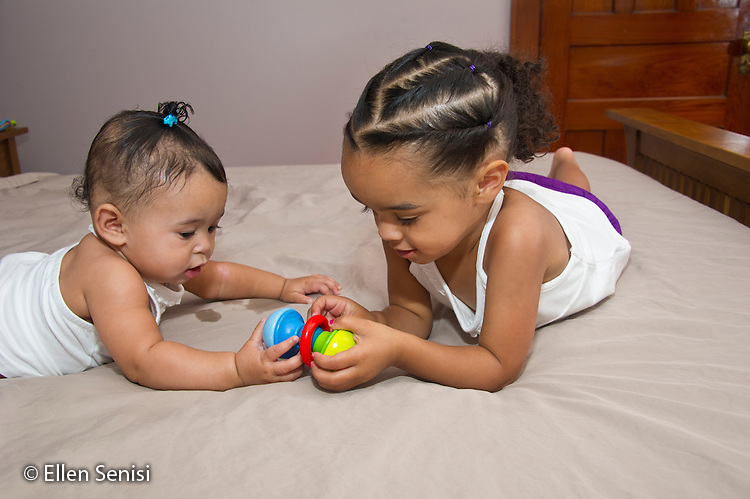 MR / Schenectady, NY. Siblings interact. Sister left: girl, 6 months, African American & Caucasian; sister right: girl, 2, African American & Caucasian. MR: Dal4, Dal5. ID: AL-HD. © Ellen B. Senisi