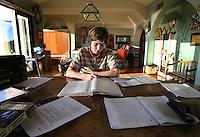 C.homework.1.1204.jl.jpg/photo Jamie Scott Lytle/Devin McDaniel an 8th grader at Valley Middle School spends hours after school working on homework.
