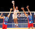 Dominican Republic's Capellan Lopez hits against Puerto Rico blockers Josue Nunez and Maurice Torres during the Pan American Cup at the Reno Events Center in Reno, Nev., on Monday, Aug. 17, 2015. <br /> Photo by Cathleen Allison