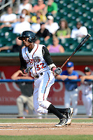 Lansing Lugnuts outfielder Carlos Ramirez (32) during a game against the Dayton Dragons on August 25, 2013 at Cooley Law School Stadium in Lansing, Michigan.  Dayton defeated Lansing 5-4 in 11 innings.  (Mike Janes/Four Seam Images)