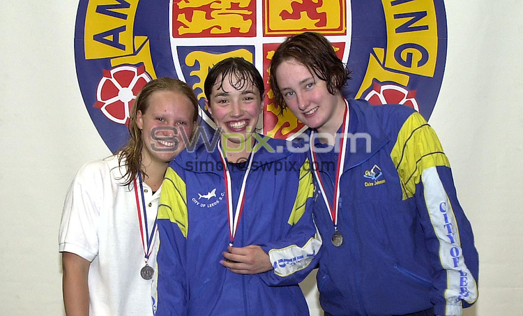 Pix: Matthew Lewis/SWpix.com. National Age Group Championships, Ponds Forge International Sports Centre, Sheffield. 1/08/2001..COPYWRIGHT PICTURE>>SIMON WILKINSON>>01943 436649>>..Girls 16yrs 400m Freestyle Final medal presentation. (From L to R), Marie Jones, Millfield (Bronze), Rebecca Shaw, Co Leeds (Gold), Claire Johnson, Co Leeds (Silver).
