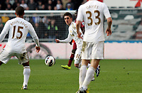 Saturday 2nd March 2013<br /> Pictured: (L-R) Wayne Routledge, Pablo Hernandez, Ben Davies.<br /> Re: Barclays Premier Leaguel, Swansea  v Newcastle at the Liberty Stadium in Swansea.