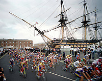 7/7/1994 Tour de France 1994.<br /> Stage 5 - Portsmouth.<br /> The peloton races past HMS Victory in Portsmouth Dockyard.<br /> Photo: Offside / L'Equipe. COPYRIGHT WARNING : THIS IMAGE IS RIGHTS MANAGED AND THE COPYRIGHT MAY SIT WITH A THIRD PARTY PLEASE CONTACT simon@swpix.com BEFORE DOWNLOAD AND OR USE