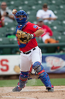 Round Rock Express catcher Dusty Brown #2 throws to first base during the Pacific Coast League baseball game against the Iowa Cubs on April 15, 2012 at the Dell Diamond in Round Rock, Texas. The Express beat the Cubs 11-10 in 13 innings. (Andrew Woolley / Four Seam Images).
