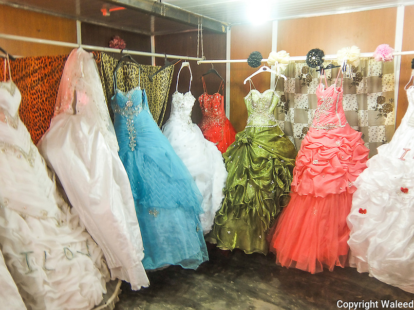 """""""Weddings Despite Agony.<br /> We went to the wedding dress shop to see the bridal gowns for rent."""""""