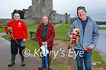 Robert Jr O'Shea with Gizmo the dog, Robert Sr O'Brien and Con Healy with Buddy the dog enjoying a stroll near Ross Castle in Killarney on Saturday.