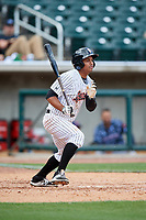 Birmingham Barons shortstop Cleuluis Rondon (7) follows through on a swing during a game against the Jacksonville Jumbo Shrimp on April 24, 2017 at Regions Field in Birmingham, Alabama.  Jacksonville defeated Birmingham 4-1.  (Mike Janes/Four Seam Images)