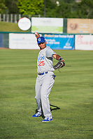 Michael Medina (25) of the Ogden Raptors warms up in the outfield before the game against the Orem Owlz in Pioneer League action at Home of the Owlz on June 20, 2015 in Provo, Utah. The Raptors defeated the Owlz 9-6.   (Stephen Smith/Four Seam Images)
