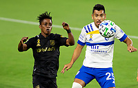 LOS ANGELES, CA - SEPTEMBER 02: Andres Riosc #25 of the San Jose Earthquakes slide tackles Latif Blessing #7 of LAFC during a game between San Jose Earthquakes and Los Angeles FC at Banc of California stadium on September 02, 2020 in Los Angeles, California.