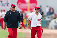 Fresno Grizzlies starting pitcher Brady Dragmire (17) and pitching coach Brad Holman walk towards the dugout before a game against the Reno Aces at Chukchansi Park on April 8, 2019 in Fresno, California. Fresno defeated Reno 7-6. (Zachary Lucy/Four Seam Images)