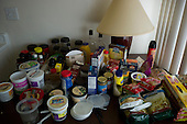 Los Angeles, California<br /> January 28, 2014<br /> <br /> Former homeless veteran Michael Brody 72 yrs old in his apartment that he has because of a HUD Vash voucher. His food is arranged on the kitchen table top.