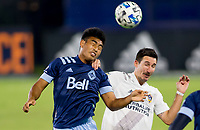 CARSON, CA - OCTOBER 18: Michael Baldisimo of the Vancouver Whitecaps battles with Sacha Kljestan #16 of the Los Angeles Galaxy for an air ball during a game between Vancouver Whitecaps and Los Angeles Galaxy at Dignity Heath Sports Park on October 18, 2020 in Carson, California.