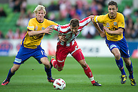 MELBOURNE, AUSTRALIA - OCTOBER 23: Nick Kalmar of the Heart and Bas van den Brink of Gold Coast compete for the ball during the A-League match between the Melbourne Heart and Gold Coast United at AAMI Park on October 23, 2010 in Melbourne, Australia. (Photo by Sydney Low / Asterisk Images)