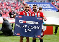 29th May 2021; Wembley Stadium, London, England; English Football League Championship Football, Playoff Final, Brentford FC versus Swansea City; Bryan Mbeumo of Brentford and Saman Ghoddos of Brentford pose with We're Going Up banner after they won 2-0 and promoted to the premier league