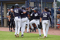 FCL Yankees Jose Martinez (36) celebrates with Dionys Vallejo (41), Madison Santos (34), and Jose Colmenares (12) after hitting a home run during a game against the FCL Phillies on July 6, 2021 at the Yankees Minor League Complex in Tampa, Florida.  (Mike Janes/Four Seam Images)