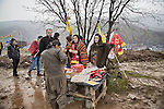 22/03/15 -- Qandil, Iraq -- Iranian Kurds sell PKK merchandise in Qandel. Qandel is the only place where Kurds from Iraq, Iran, Sirya and Turkey gather to celebrate Newroz.