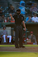 Home plate umpire Andrew Barrett calls a strike during a California League game between the Lancaster JetHawks and the Inland Empire 66ers at San Manuel Stadium on May 19, 2018 in San Bernardino, California. Inland Empire defeated Lancaster 9-6. (Zachary Lucy/Four Seam Images)