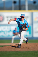 Spokane Indians relief pitcher Wes Robertson (14) follows through on his delivery during a Northwest League game against the Vancouver Canadians at Avista Stadium on September 2, 2018 in Spokane, Washington. The Spokane Indians defeated the Vancouver Canadians by a score of 3-1. (Zachary Lucy/Four Seam Images)