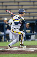 Michigan Wolverines third baseman Jake Bivens (18) follows through on his swing against the Bowling Green Falcons on April 6, 2016 at Ray Fisher Stadium in Ann Arbor, Michigan. Michigan defeated Bowling Green 5-0. (Andrew Woolley/Four Seam Images)