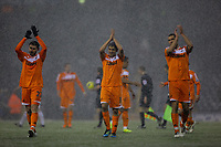 Pictured L-R: Team mates Angel Rangel, Neil Taylor and Steven Caulker of Swansea greeting supporters after the final whistle. Saturday, 04 February 2012<br /> Re: Premier League football, West Bromwich Albion v Swansea City FC v at the Hawthorns Stadium, Birmingham, West Midlands.
