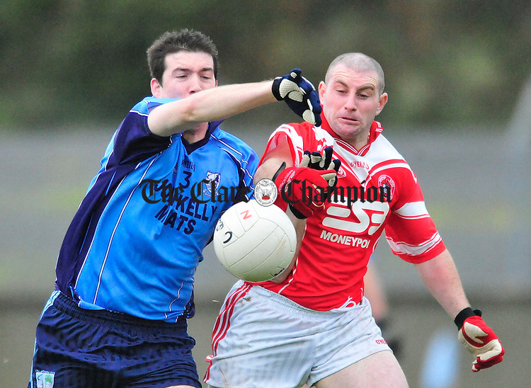 Kildysart Captain Shane Mc Nelis clashes with Seamus Boland of St Eoin's. Photograph by Declan Monaghan