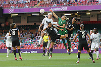 Jenny BINDON of New Zealand punches clear from Stephanie HOUGHTON of Great Britain - Great Britain Women vs New Zealand Women - Womens Olympic Football Tournament London 2012 Group E at the Millenium Stadium, Cardiff, Wales - 25/07/12 - MANDATORY CREDIT: Gavin Ellis/SHEKICKS/TGSPHOTO - Self billing applies where appropriate - 0845 094 6026 - contact@tgsphoto.co.uk - NO UNPAID USE.