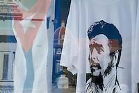 Che Guevara T-shirt and Cuban flag in a store window, Cienfuegos, Cuba.