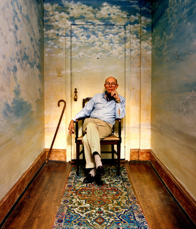 Simmons Jones, a New York fashion photographer in the 1950's and 60's for clients such as VOGUE, sits in his home. The clouds on the wall and ceiling where painted by Jones as therapy while he tried to overcome alcohol addiction.