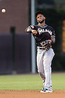 Miami Marlins shortstop Jose Reyes #7 warms up between innings during a game against the Chicago Cubs at Wrigley Field on July 17, 2012 in Chicago, Illinois. The Marlins defeated the Cubs 9-5. (Tony Farlow/Four Seam Images).