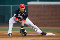 First baseman Paul Karmas #31 of the St. John's Red Storm stretches for a low throw against the Virginia Cavaliers in the championship game of the Charlottesville Regional at Davenport Field on June 7, 2010, in Charlottesville, Virginia.  The Cavaliers defeated the Red Storm 5-3.  Photo by Brian Westerholt / Four Seam Images