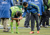 November, 2013: CenturyLink Field, Seattle, Washington:  Seattle Sounders FC midfielder/forward David Estrada (16) encourages Seattle Sounders FC midfielder/forward Lamar Neagle (27) after the Portland Timbers defeat  the Seattle Sounders FC 2-1 in the Major League Soccer Playoffs semifinals Round.