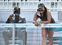 MIAMI GARDENS, FL - MARCH 29: Leonard Francois and Tamaki Osaka is seen watching Naomi Osaka Vs Elise Mertens at the 2021Miami Open at Hard Rock Stadium on March 29, 2021 in Miami Gardens, Florida. <br /> CAP/MPI04<br /> ©MPI04/Capital Pictures