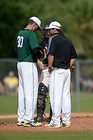 Farmingdale State Rams pitching coach Kevin Salmon talks with Dalton McCarthy (30) and catcher Ryan Jordan during a game against the U-Mass Boston Beacons at North Charlotte Regional Park on March 19, 2015 in Port Charlotte, Florida.  U-Mass Boston defeated Farmingdale 9-5.  (Mike Janes/Four Seam Images)