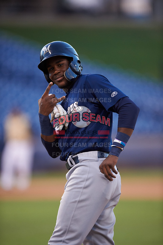 AZL Brewers Blue Arbert Cipion (23) poses for a photo after getting a hit during an Arizona League game against the AZL Brewers Gold on July 13, 2019 at American Family Fields of Phoenix in Phoenix, Arizona. The AZL Brewers Blue defeated the AZL Brewers Gold 6-0. (Zachary Lucy/Four Seam Images)