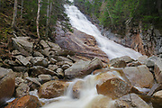 Crawford Notch State Park - Ripley Falls on Avalanche Brook in Hart's Location, New Hampshire USA during the spring months. The Arethusa-Ripley Falls Trail travels pass this scenic waterfall. Named for H.W. Ripley, this waterfall was discovered in the 1850s (maybe even earlier).