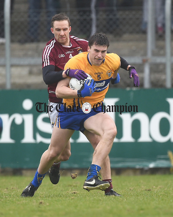 Jamie Malone of Clare in action against Kevin Maguire of Westmeath during their league game in Cusack Park. Photograph by John Kelly.